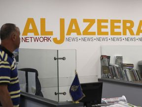 Employees of Qatar based news network and TV channel Al-Jazeera are seen at their Jerusalem office on July 31, 2017, / AFP PHOTO / AHMAD GHARABLI (Photo credit should read AHMAD GHARABLI/AFP/Getty Images) Restrictions