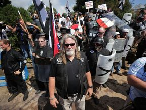 White nationalists, neo-Nazis and members of the 'alt-right' exchange insults with counter-protesters as they attempt to guard the entrance to Lee Park during the 'Unite the Right' rally August 12
