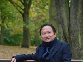 Vietnamese national Xuan Thanh sitting on a park bench in Berlin