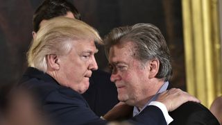 US President Donald Trump (L) congratulates Senior Counselor to the President Stephen Bannon during the swearing-in of senior staff in the East Room of the White House on January 22, 2017 in Washington, DC. / AFP / MANDEL NGAN (Photo credit should read MANDEL NGAN/AFP/Getty Images)