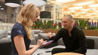 Tech magician Tom London entertains Swipe's Gemma Morris with some tricks