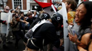 Members of white nationalists clash a group of counter-protesters in Charlottesville, Virginia