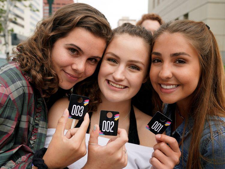 Taylor Swift fans (L-R) Grace Jarecke, Lucy Peterson and Dani Kuta outside court