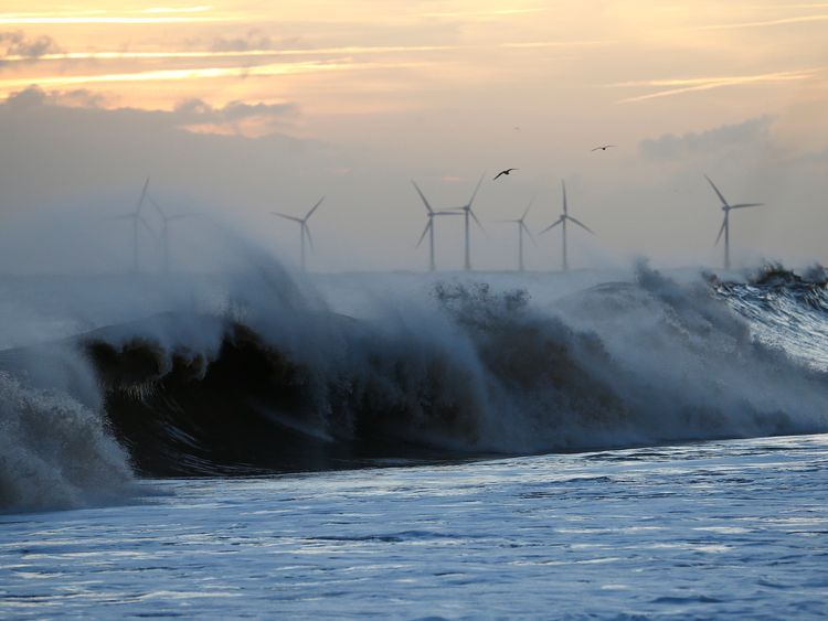 Waves crash onto the beach after a storm surge in Hemsby, eastern England December 6, 2013