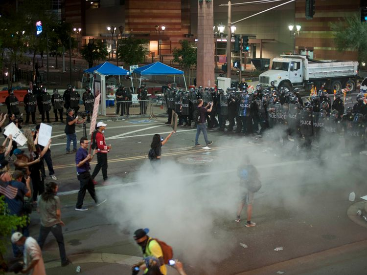 Police use tear gas to break up protesters