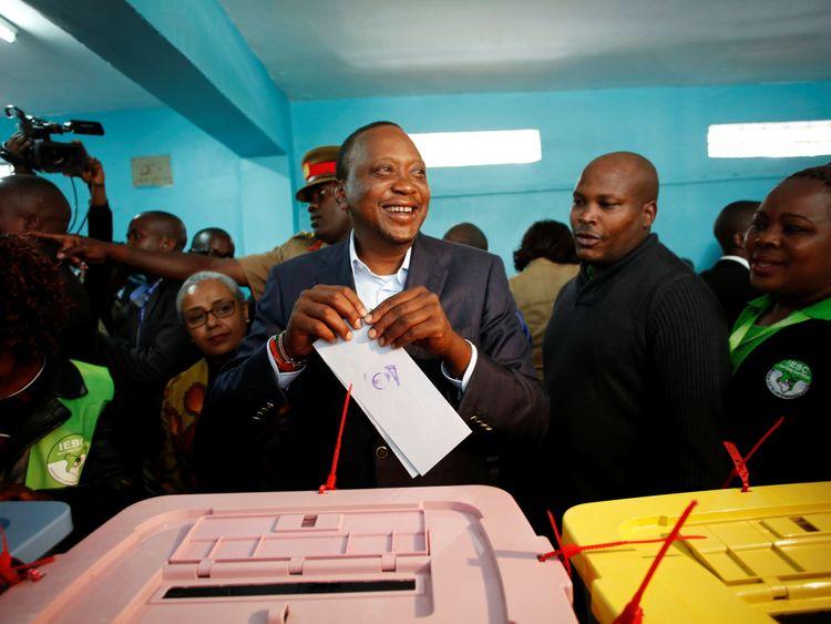 President Uhuru Kenyatta casts his vote in the election