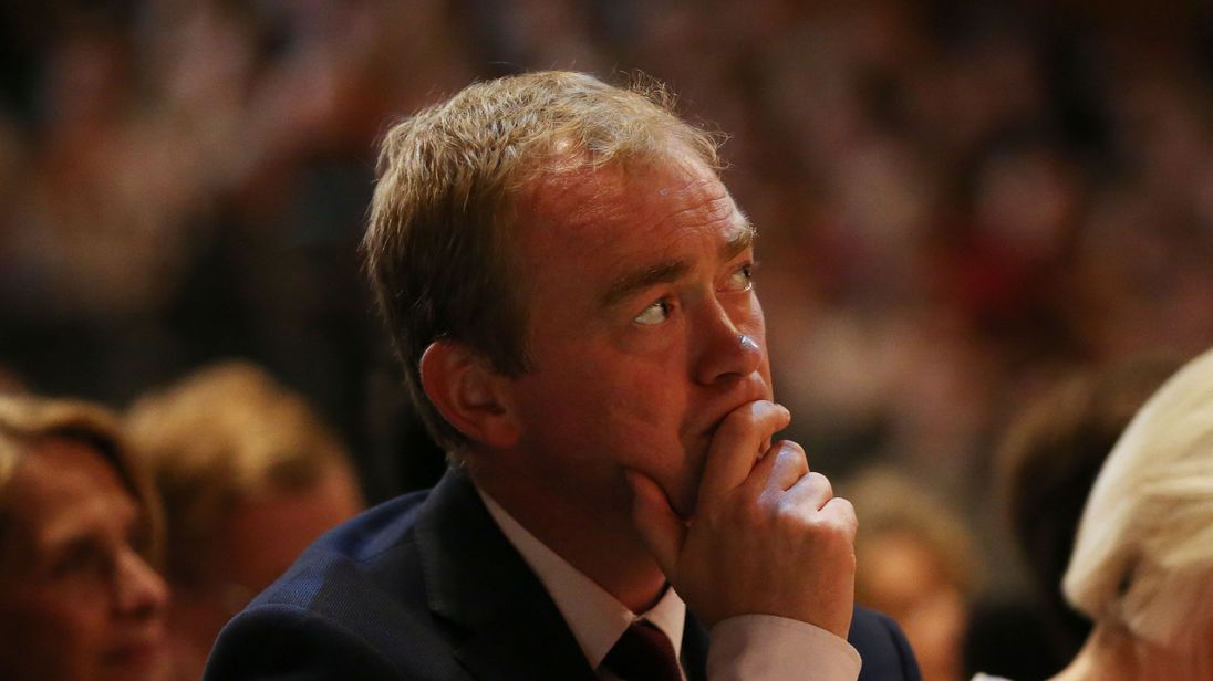 Former leader Tim Farron listens to Sir Vince Cable's speech