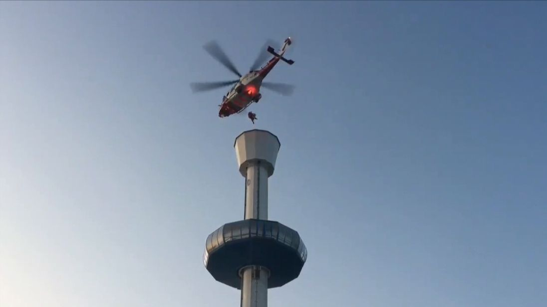 Dorset and Wiltshire Fire and Rescue Service airlifts 13 people from the gondola of the Jurassic Skyline tower in Weymouth