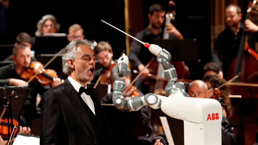 Humanoid robot YuMi conducts the Lucca Philharmonic Orchestra performing a concert alongside Italian tenor Andrea Bocelli