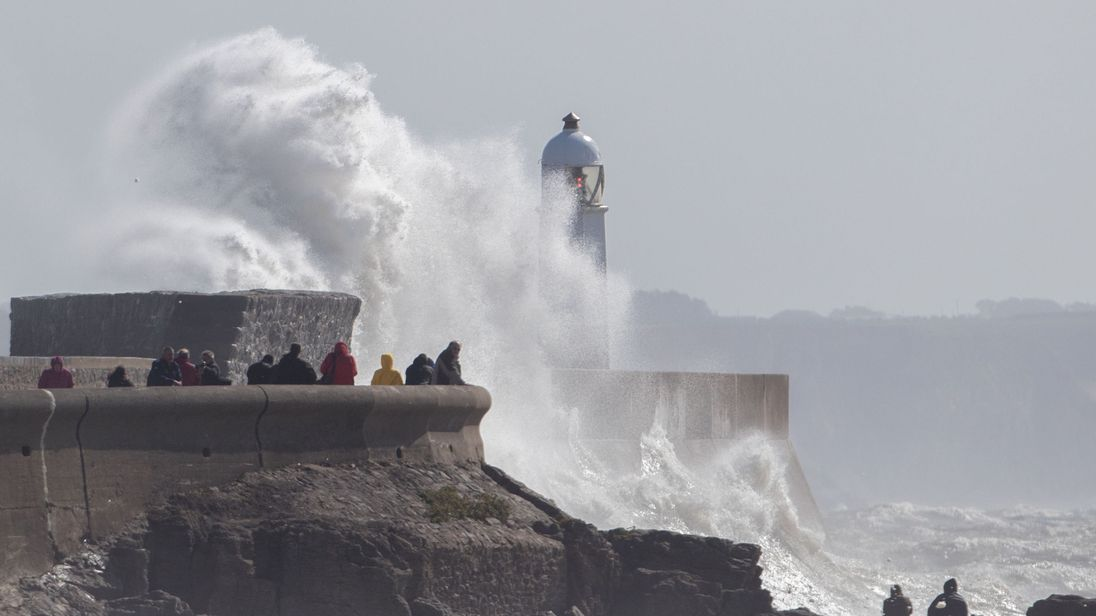 Waves break over the coastline at Porthcawl in Wales