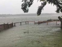 Water level rises, flooding Charleston Harbour, South Carolina