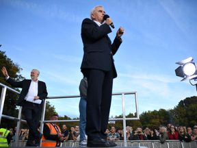 John McDonnell and Jeremy Corbyn at a Momentum rally in Brighton