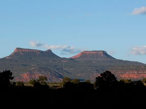 The two bluffs known as the 'Bears Ears' seen at sunset in the Bears Ears National Monument in Utah