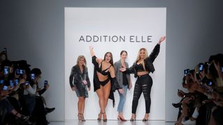 Models Ashley Graham and Jordyn Woods acknowledge attendees during the finale of the Addition Elle Spring/Summer 2018 presentation