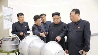 North Korea's Korean Central News Agency released this photo of Kim Jong Un inspecting  the device