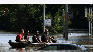 Rescue teams work their way through each neighbourhood