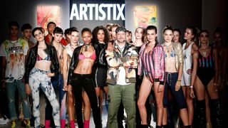 Designer Greg Polisseni appears on the runway during the Andy Hilfiger Presents Artistix By Greg Polisseni fashion show