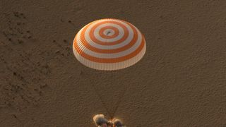 In this handout photo provided by NASA, the Soyuz MS-04 spacecraft is seen as it lands with Expedition 52 Commander Fyodor Yurchikhin of Roscosmos and Flight Engineers Peggy Whitson and Jack Fischer of NASA near the town of Zhezkazgan, Kazakhstan