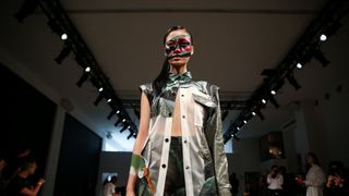 A model presents a creation from the Liu Bolin Debut collection