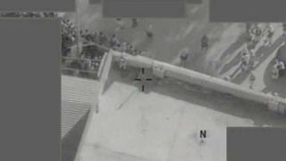 An RAF drone strike kills an Islamic State sniper on the roof of a building.