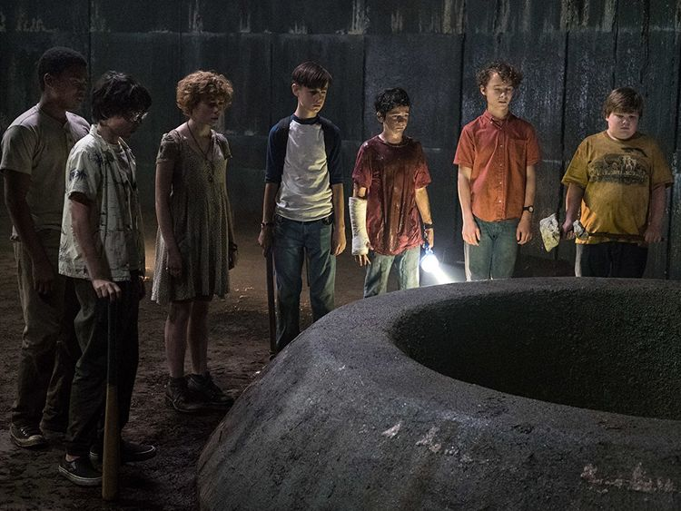 The Loser's Club looking down Pennywise's well