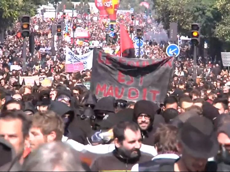 Tens of thousands of people take to the streets of Paris to demonstrate against Emmanuel Macron's labour reforms