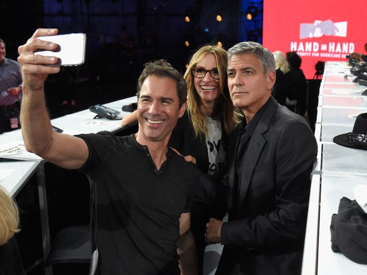 UNIVERSAL CITY, CA - SEPTEMBER 12: In this handout photo provided by Hand in Hand, Eric McCormack, Julia Roberts and George Clooney attend Hand in Hand: A Benefit for Hurricane Relief at Universal Studios AMC on September 12, 2017 in Universal City, California. (Photo by Kevin Mazur/Hand in Hand/Getty Images)