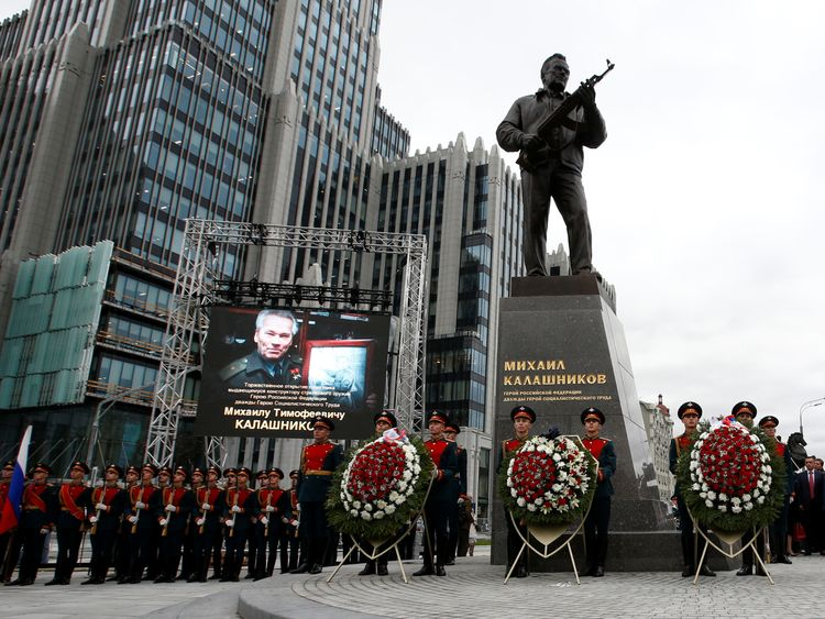 Guards of honour stand next to a monument to Mikhail Kalashnikov