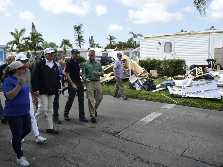 Mr Trump tours a neighbourhood affected the hurricane