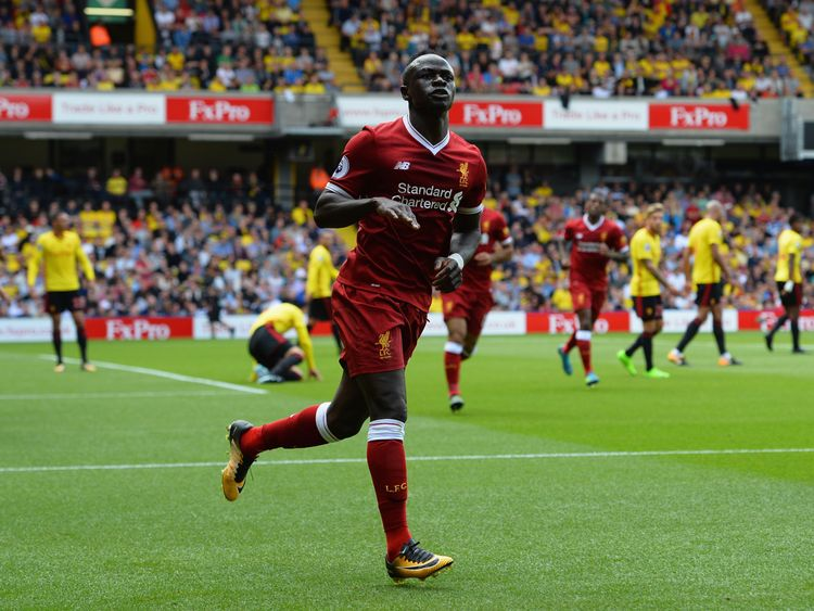 WATFORD, ENGLAND - AUGUST 12:  Sadio Mane of Liverpool celebrates scoring his sides first goal during the Premier League match between Watford and Liverpoo