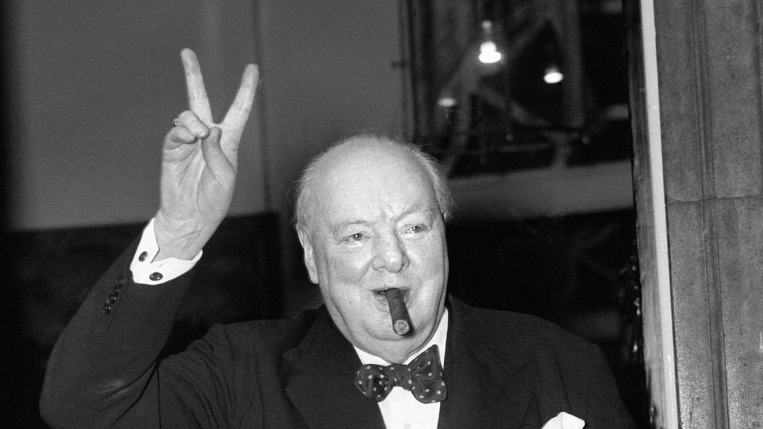 Sir Winston Churchill gives his familiar 'V' sign after a lunchtime meeting with American Secretary of State John Foster Dulles. 17-Sep-1954