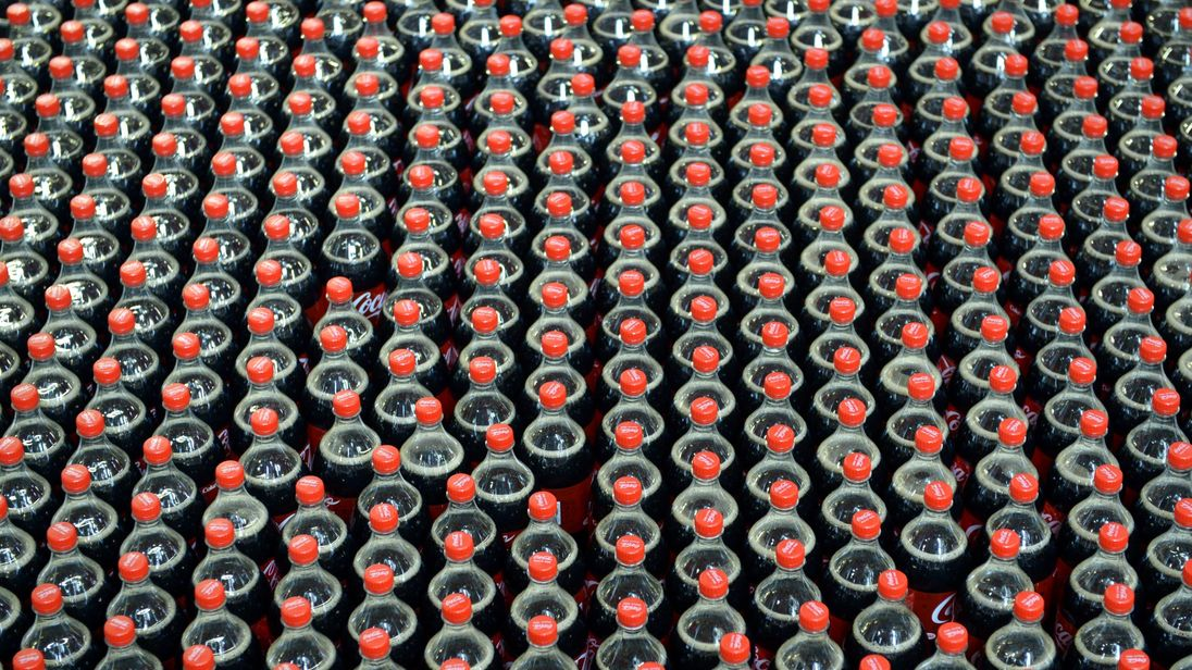 Coca-Cola soft drink bottles on the assembly line