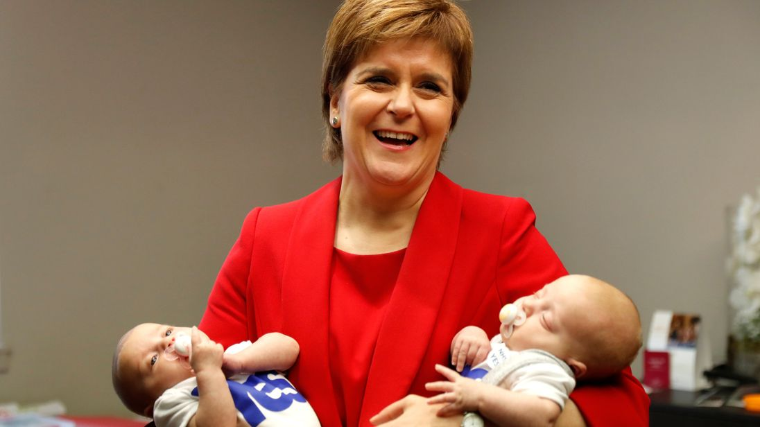 Scotland's First Minister Nicola Sturgeon, holds two babies during a visit to the conference creche at the Scottish National Party (SNP) conference in Glasgow, Scotland, October 9, 2017