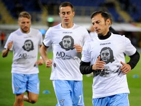 Stefan Radu of Lazio wears a shirt depicting Anne Frank saying 'no to anti-Semitism'