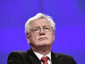 British Secretary of State for Exiting the European Union (Brexit Minister) David Davis addresses media representatives at the European Union Commission in Brussels on October 12, 2017