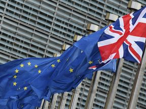 The Union Jack flag flies next to European Union flags in front of the European Commission building as British Prime Minister May is due to meet European Commission President Juncker