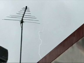 Amateur footage shows a plane appearing to be hit by lightning in Australia