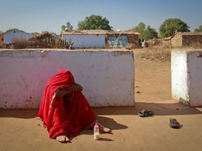 A 14-year-old bride photographed in India in 2013