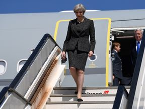 Theresa May arriving in Brussels for a NATO summit in May