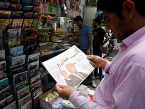 A copy of the Iranian newspaper Aftab bearing a caricature of Donald Trump