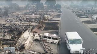 A postman delivers mail in fire-devastated Santa Rosa, California