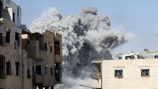 Smoke rises at the positions of the Islamic State militants after an air strike by the coalition forces