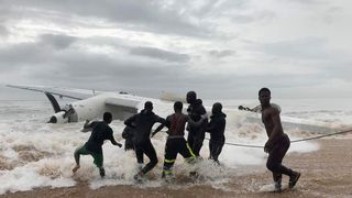 People pull the wreckage of a cargo plane after it crashed in the sea near the international airport in Ivory Coast's main city, Abidjan