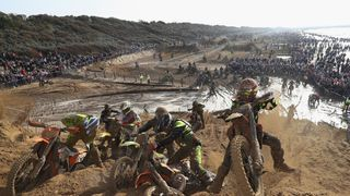 Riders climb a huge sand dune during the Adult Solo race during day two of the HydroGarden Weston Beach Race in Weston-Super-Mare
