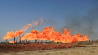 Flames emerge from flare stacks at the oil fields in Kirkuk, Iraq