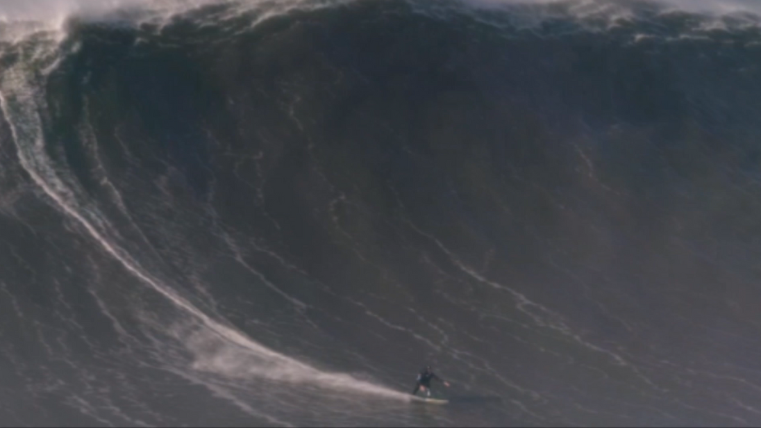 British surfer Andrew Cotton broke his back when he was taken out by a huge wave in Portugal