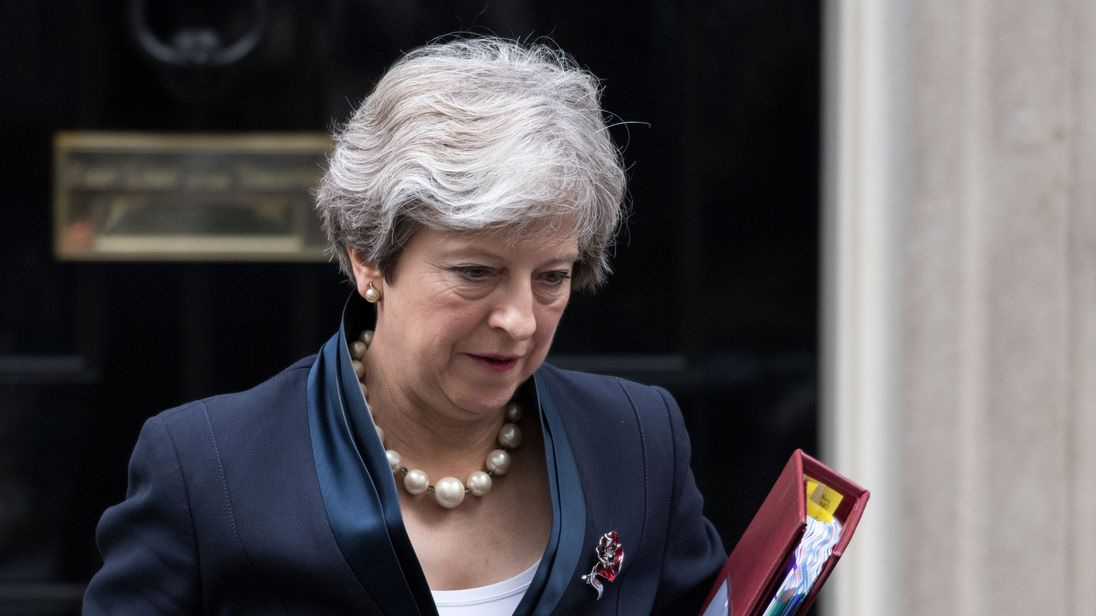Theresa May leaves Downing Street ahead of Prime Minister's Questions