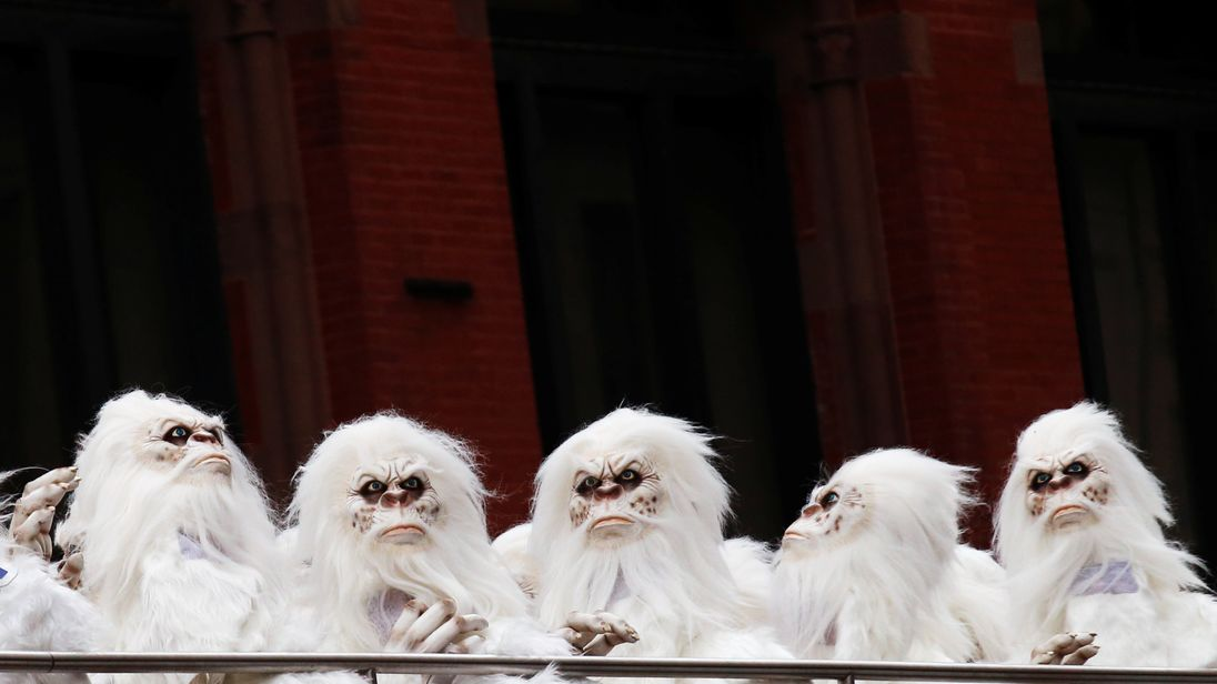 """Actors dressed as a 'Yeti' ride aboard a tour bus during a promotional event for Travel Channel's """"Expedition Unknown: Hunt for the Yeti"""" in Manhattan, New York City"""