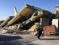 A damaged building following an earthquake in Darbandikhan in Sulaimaniya Governorate, Iraq