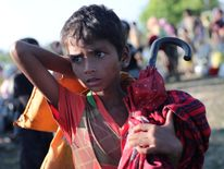 A child refugee is temporarily detained by the border guard in Bangladesh